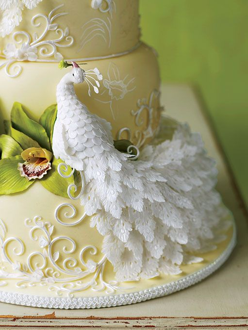 Brides.com: All Things Peacock. A white gumpaste peacock perched on one of the tiers can be an elegant addition to a more traditional-looking cake design. Cake by Flora's Divine Cakes, Las Vegas