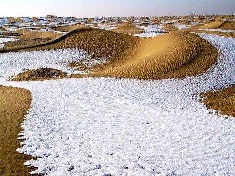 Irregular desert. Snow and Sand in Tunisia.