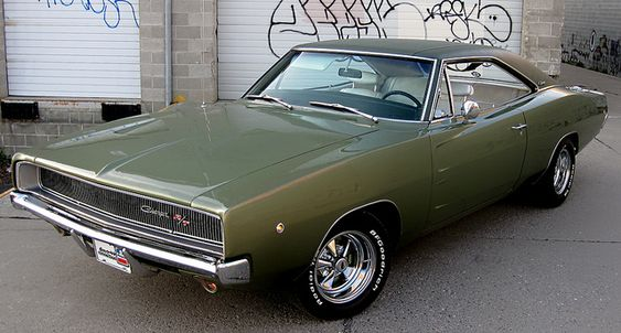 """1968 - Dodge Charger R/T (Road and Track) The entire B-body lineup for 1968 was redesigned and the Charger was further differentiated from the Dodge Coronet models. Designer Richard Sias developed a double-diamond coke bottle profile with curves around the front fenders and rear quarter panels. The rear end featured a """"kick up"""" spoiler appearance, inspired by Group 7 racing vehicles."""