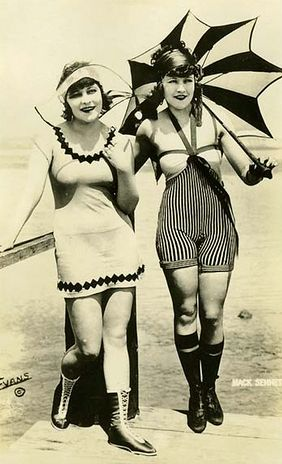 Vintage bathing beauties, dressed for the beach with dramatic parasol. c1920-30 (probably).