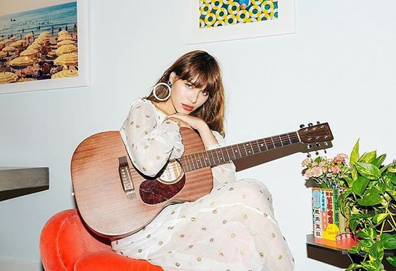 Strumming my guitar. 🌿 📸 @emmy_park