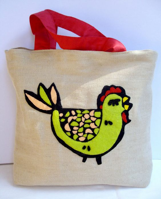 Adorable and probably pretty easy to make for yourself with felt. CHICKEN TOTE BAG!