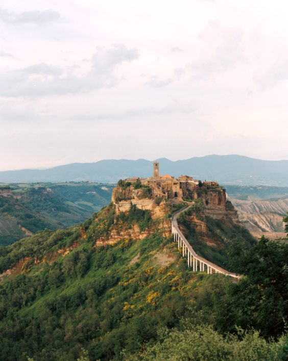 Hike to the top of this incredible hilltop hideaway in Civita di Bagnoregio, #Italy. Experience the most breathtaking views of Italy from above!