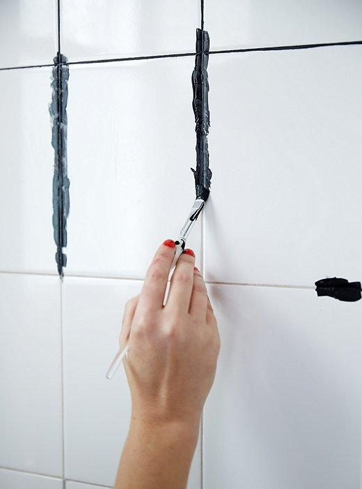 """How to DIY dye your white grout black! Such an easy DIY that can completely transform your bathroom or kitchen -- and no more dirty grout! Get inspired to make your own bathroom makeover happen with the tips and ideas from """"A Contractor-Free Bathroom Renovation You Wont Believe!"""" on the  One Kings Lane Style Guide!"""