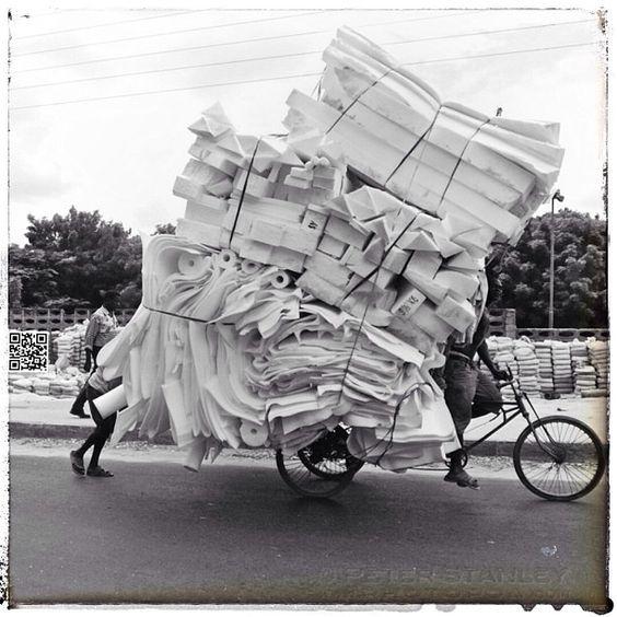 #daressalaam #tanzania #loaded bike transporting foam for making beds. #streetphotography