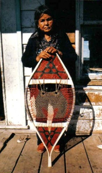 """Atikamekw woman with a snowshoe, 1979. An old Native American saying goes: """"The white man always attempted to avoid the snow or skirt it, whereas the Indian always looked for the best way to walk on it and live in harmony with nature."""""""