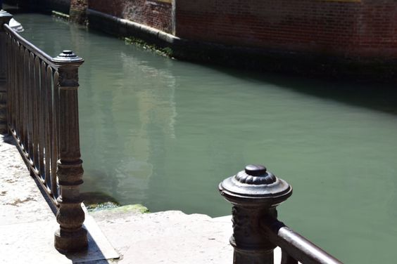 The ironwork looks amazing against the canal waters in Venice