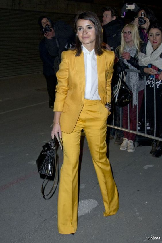 Some stars have been wearing red pantsuits of late. Miroslava Duma went for an all-yellow look for this edition of Paris Fashion Week.