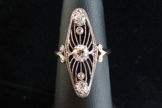 Antique Edwardian / Art Nouveau Open Filigree Navette Ring w/ Old European Cut & Rose Cut Diamonds -   https://www.etsy.com/listing/224741740/antique-14k-platinum-early-edwardian?ref=shop_home_feat_1=sc_3&plkey=86d1c7c769ca226e1675862275edc7e2dd174774%3A224741740&ga_search_query=antique+edwardian+filigree+ring&ga_search_type=all&ga_view_type=gallery