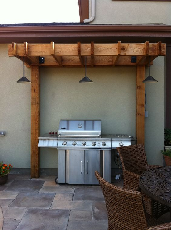 Arbor With Lighting Over Grill Outdoor Living Room