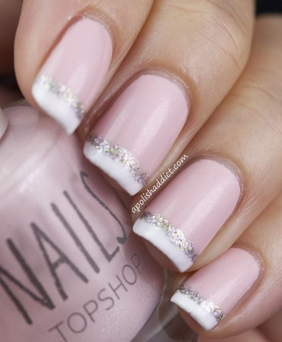 """Base color was two coats of Topshop """"Powder.""""  For the tips, I used OPI """"Alpine Snow.""""  Then I applied a thin strip of Nails Inc """"Noel Street (silver glitter) to mask the imperfect tips."""