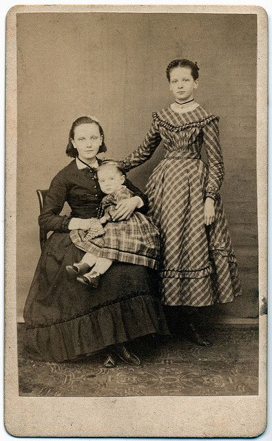 I have no idea who these people are but I adore old pictures and those old dresses.: