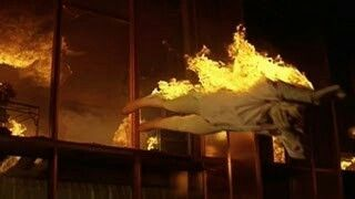Falling of Susan Flannery covered with flames