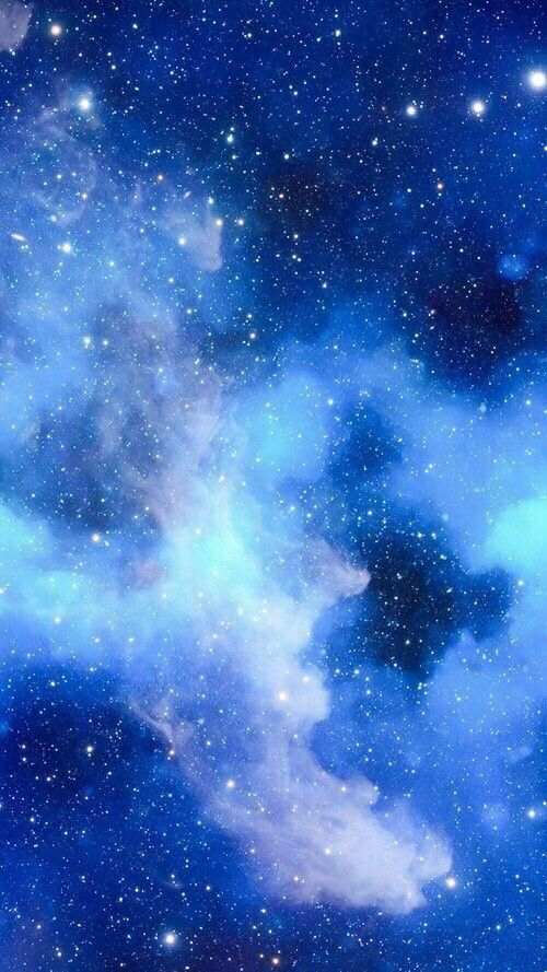 The Stars Shine Bright Peeking Through The Blue Clouds And The Black Sky