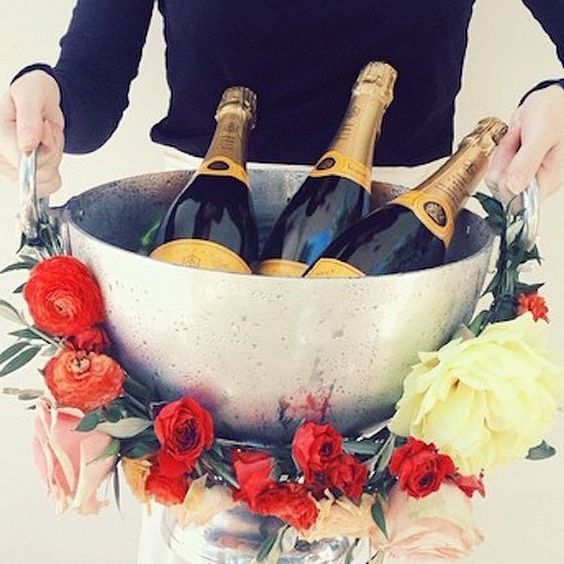 #ClicquotDia tip: Dress your Champagne bucket w/ peonies, ranunculus, roses
