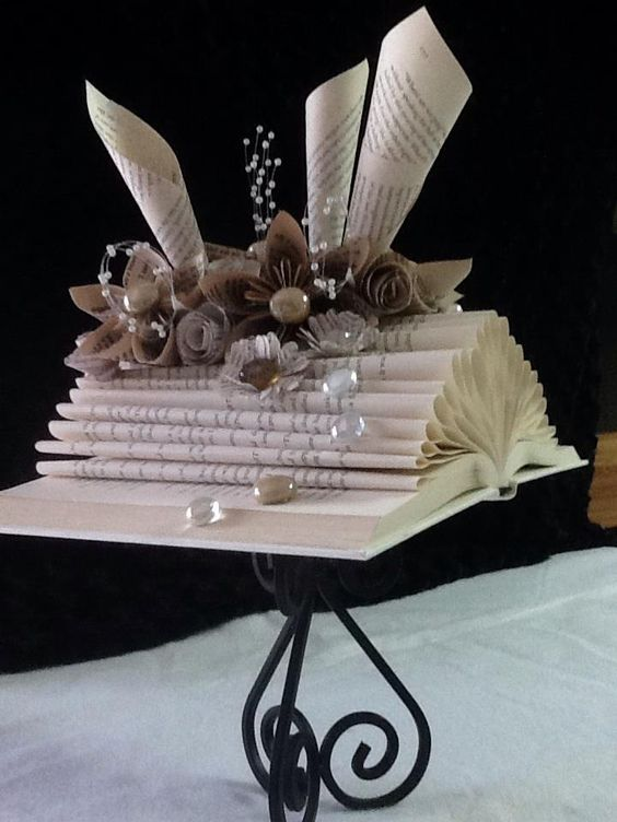 Folded altered book on stand by ART in HEART