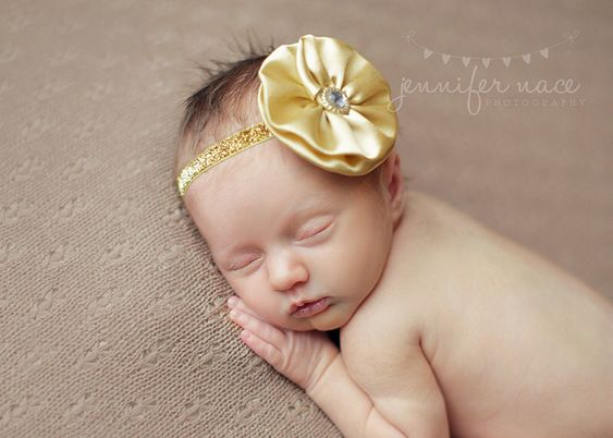 A personal favorite from my Etsy shop https://www.etsy.com/listing/128230615/gold-baby-headband-infant-headband-baby
