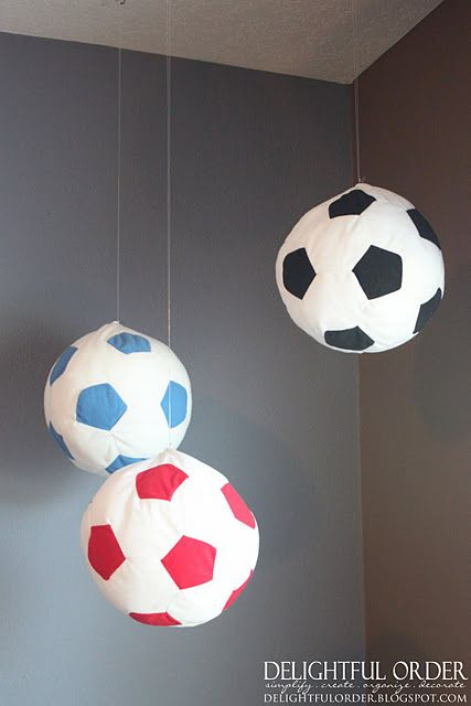 soccer balls from ikea!  love this idea! or painted rice paper lamps...