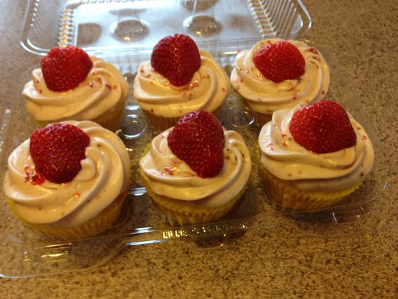 Lemon yogurt cupcake with lemon curd filling topped with a strawberry cream cheese buttercream!