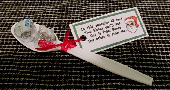 Candy kisses glued to spoon.  Tag reads: In this spoon two kisses you will see, One is from Santa and the other is from me.