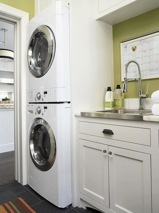 Mudroom: stacked washer & dryer with a utility sink.