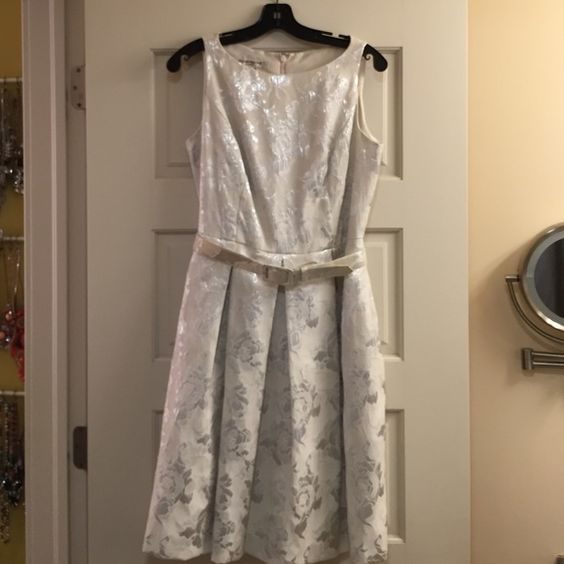 Off White & Silver Dress This is a perfect party or event dress. It's white with a silver floral pattern. It had a matching belt, zips down the back and has side pockets. Evan Picone Dresses Midi