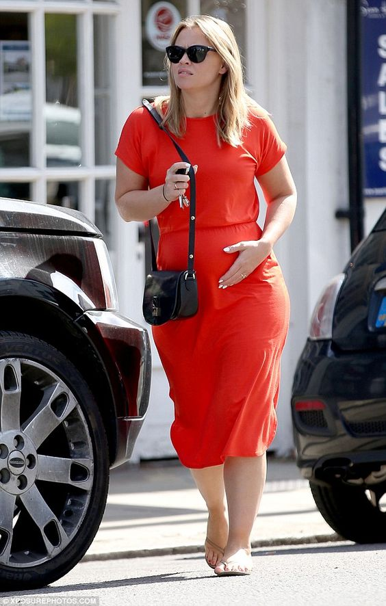 Baby and me: Pregnant Kimberley Walsh kept a hand on her bump as she headed out and about in the sunshine on Thursday
