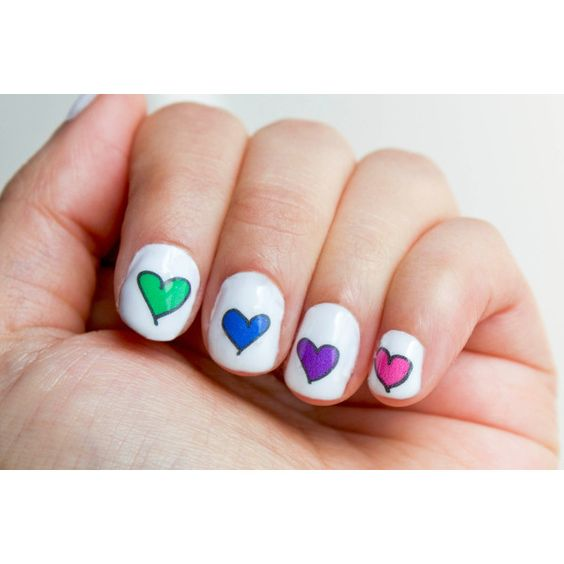 SALE! 42 Rainbow Hearts Nail Decals Nail Decals (5.29 CAD) ❤ liked on Polyvore featuring beauty products, nail care, nail treatments, nails and fungal nail treatment