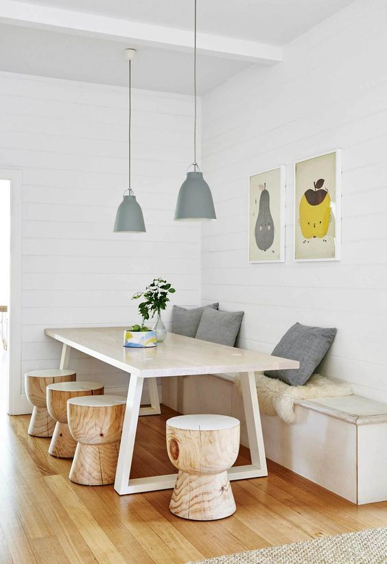 Breakfast nook: This eat-in corner nook in the kitchen features a custom bench seat crafted by builder Mark Mulheron, as well as a table and 'Eggcup' stools from Mark Tuckey. A pair of Fine Little Day artworks reflects the home's welcoming atmosphere. Cushions & bowl, Stone and Grain.
