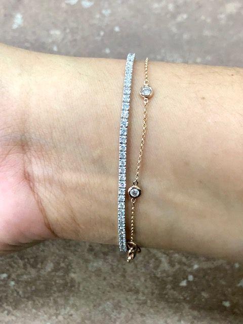 This Eye Catching Tennis Bracelet Adorns Your Wrist With Sparkling Diamonds Tennisbracelet Whitegold Pampillonia Sparkle Diamonds Tennis Bracelet Diamond