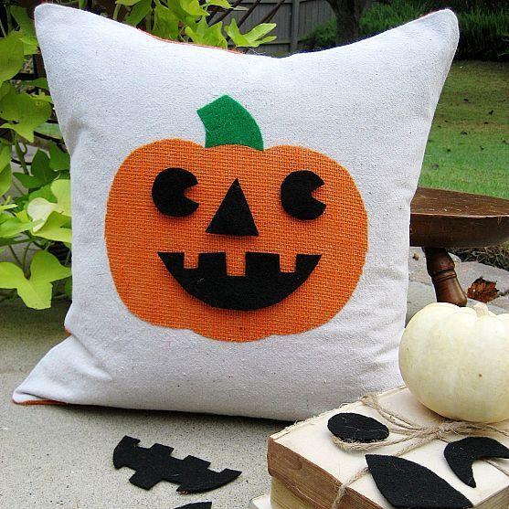 DIY Pumpkin pillow with changeable face. Cute!
