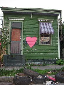 A modest shotgun house in New Orleans's Bayou St. John neighborhood shortly after Hurricane Katrina. Shotgun houses consist of three to five rooms in a row with no hallways and have a narrow, rectangular structure.