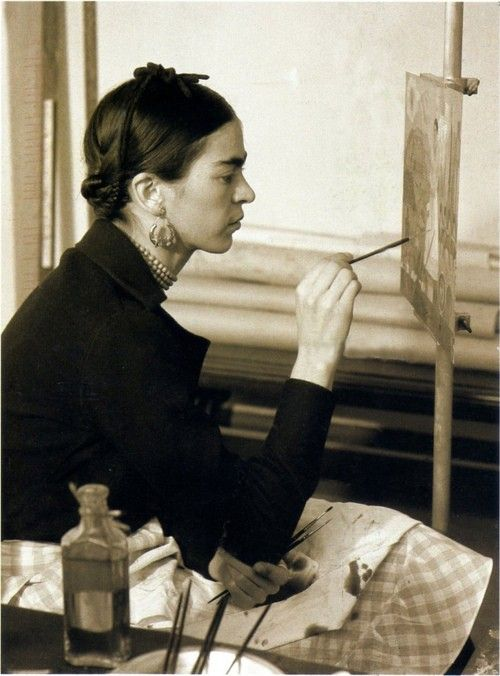 """""""Frida Kahlo painting a self-portrait"""" Frida Kahlo de Rivera (6 July 1907—13 July 1954) was born Magdalena Carmen Frieda Kahlo y Calderón. She was a Mexican painter, born in Coyoacán, and is perhaps best known for her self-portraits. Photographer unknown."""