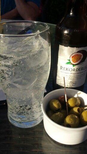 Summer time passion fruit cider and olives