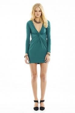 Go from work to play with this elegant long sleeved jersey dress featuring twisted detail below the bust.