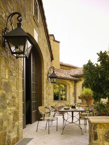 Example of keying stone around corner or edge. mediterranean patio by RJ Dailey Construction Co.