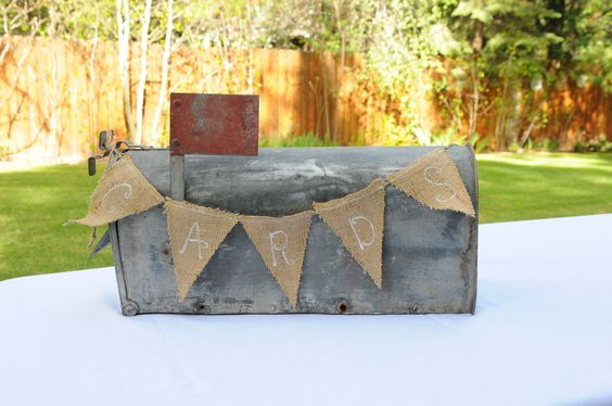This vintage mailbox makes the perfect card holder.  I just love the pennant banner, too!