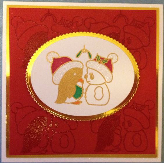 Inkwell Stamps 'Under the Mistletoe'. Clear embossed 4 times to create the background and then in gold embossing powder for the plaque.