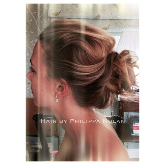 The low disheveled top knot