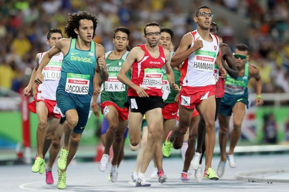 Yeltsin Jacques of Brazil and Bilel Hammami of Tunisia lead the pack in the men's 1500 meter T13 final at Olympic Stadium during day 4 of the Rio 2016 Paralympic Games on September 10, 2016 in Rio de Janeiro, Brazil.  (Photo by Matthew Stockman/Getty Images