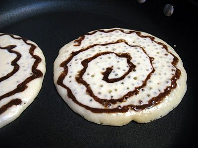 Cinnamon Roll Pancakes | Big Red Kitchen >> just pipe a swirl of cinnamon and sugar mixture over the top of the pancakes as they cook. I'm anxious to try these...
