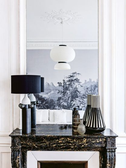 House tour: a New York family's Parisian holiday home: In the family room, lamp by Wouter Hoste Ceramics;  vases by Hedwig Bollhagen from the Galerie Patrick Fourtin in Paris; 'Formakami' ceiling light by Jaime Hayon for &Tradition.