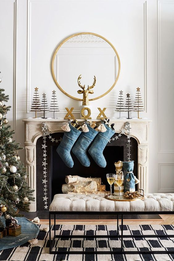 Blue denim stockings from stone mantel fireplace and gold Christmas accents.. #holidaydecor #holidaymantel #christmasdecor #christmasstockings