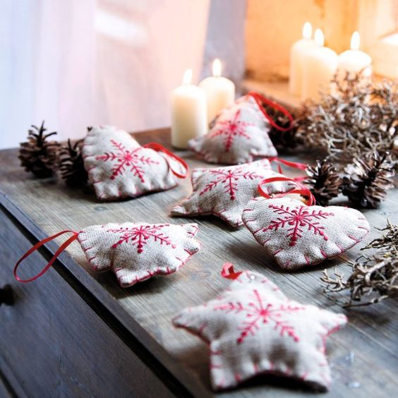 oh these would be lovely favour/decorations - sackcloth, embriodered with stars, filled with wadding... and/or dried lavender or rosemary I suppose... lovely. Could even add guest's initials, or names, or the date...