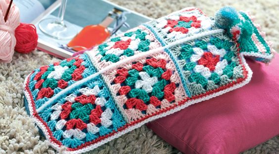 Granny square hot water bottle cosy