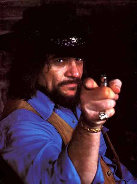 Waylon Jennings - I loved it when he said Simmer Down....in his low baritone growling voice....That always made me smile.