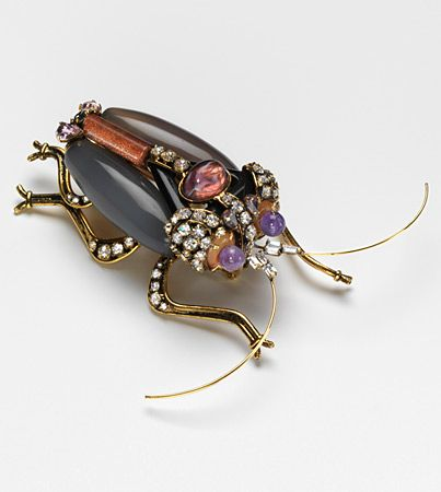 """Brooch, owned by Madeleine Albright. Brooch """"Beetle"""" , designer Iradj Moini (USA), 1997. In 1999 it was discovered that the Russians had bugged the US State Department. In her next meeting with Russia, Albright pinned this bug to her shoulder.:"""