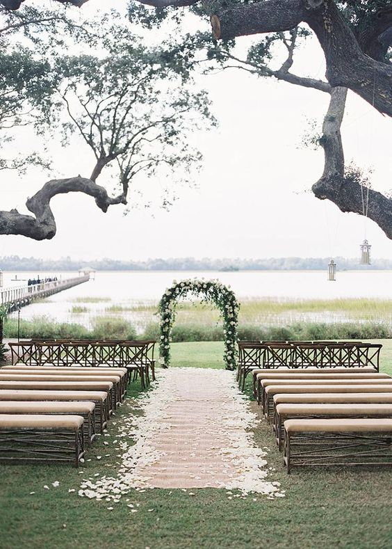 Ceremony - Lowndes Grove. Designed by Easton Events - Destination Wedding Planners with offices in Charleston, SC and Charlottesville, VA photo by Virgil Bunao