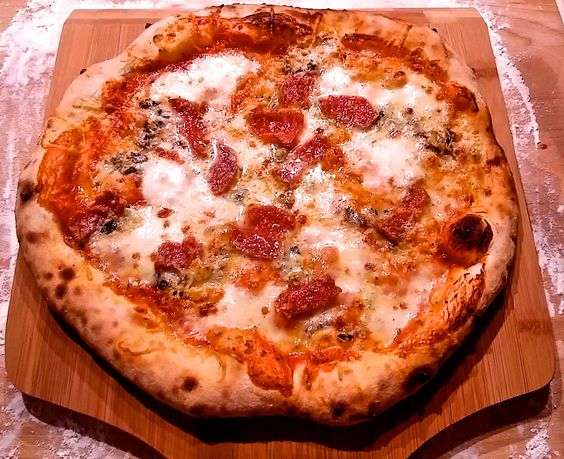 Quattro Formaggi Pizza with Salami.. best when you make it at home in a Kultique holzbackofen! #Kultique #holzbackofen