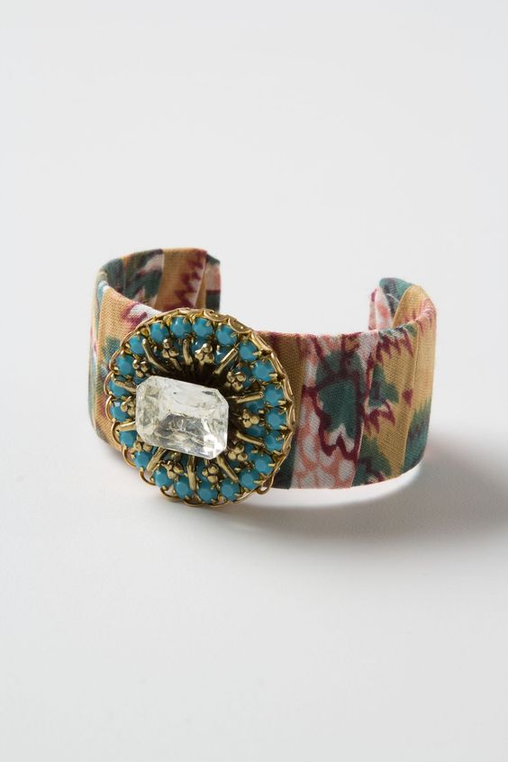 Fabric Collage Jeweled Cuff - Anthropologie.com -- refashion candidate with fabric scraps and old broach